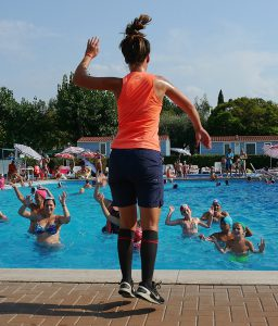 An image of women doing water aerobics