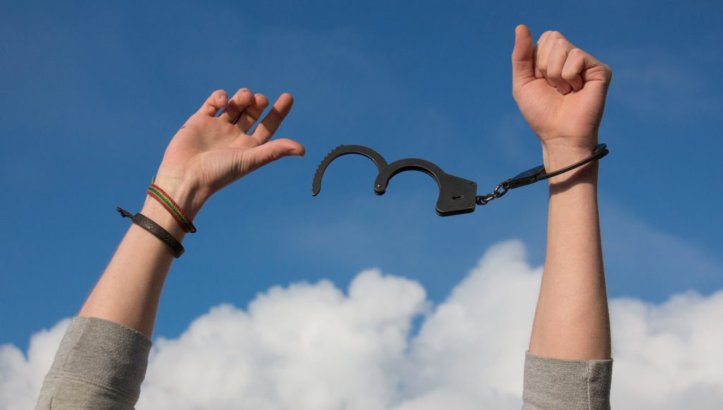 An image of chains breaking