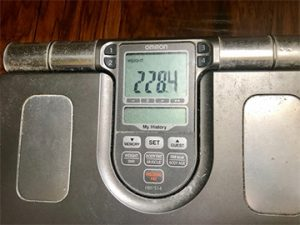 Image of scale showing weight of 228.4