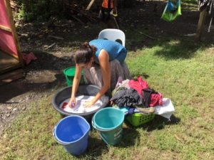 An image of Jennifer washing clothes in the village