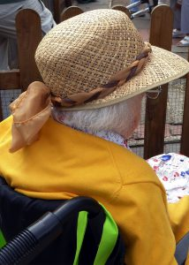 Image of woman with hat in wheelchair